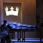 "Prince Hal (Matt Hurley) keeps vigil as his father, Henry IV (Jenifer Deal), is dying in Opera House Arts production of Shakespeare's ""Henry IV."""