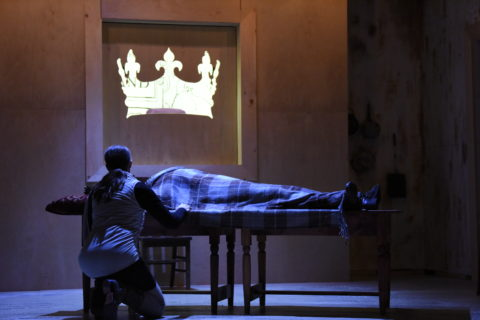 Prince Hal (Matt Hurley) keeps vigil as his father, Henry IV (Jenifer Deal), is dying in Opera House Arts production of Shakespeare's &quotHenry IV.&quot