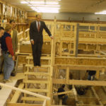 Former Gov. John Baldacci toured Lyman-Morse Boat Building Co. in Thomaston after presenting a $290,000 matching Community Development Block grant and Pine Tree Zone certification to the business to help it expand operations and add 30 new jobs.