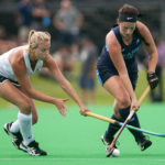University of Maine's Libby Riedl (right) and Providence's Allie Lancaster battle for control of the ball during their season opener field hockey game.