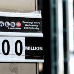 A sign displays that the Powerball jackpot is $700 million at a newsstand in New York City, U.S., August 23, 2017.
