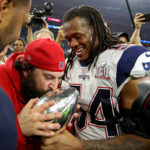 New England Patriots middle linebacker Dont'a Hightower (54) and defensive coordinator Matt Patricia celebrate with the Vince Lombardi Trophy during Super Bowl LI at NRG Stadium, Feb. 5, 2017.