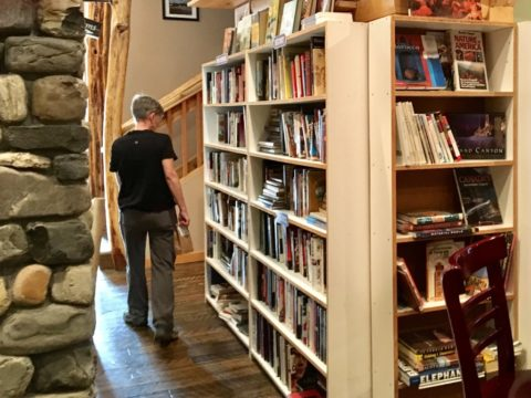 Liz Ahmann took a break from hiking in the Katahdin region to check out the shop and look over the book and food selection at Turn the Page Bookstore and Wine Bar in Millinocket.