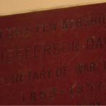 The First Parish Unitarian Universalist Church is debating whether to remove a rectangular plaque honoring Confederate President Jefferson Davis.