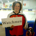 Caroline Lerch holds a sign depicting one of the five final names for the hockey team, Watchmen.