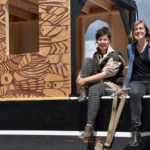 """Emily du Houx and Morgan Rogers with the boat they built, the Michi Zeebee, at the """"road trip"""" launching in Portland, Maine just before they left for St. Paul for their 2,000 journey down the Mississippi River to New Orleans."""