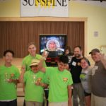 Attending Camp Sunshine, teens celebrate after winning the Camp Sunshine Pinball Tournament, led by Jeff Parsons from the 97.9 Q Morning Show.