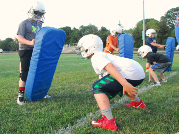 Kids workout at the Junior Rams football clinic on  Aug. 9, at Cameron Stadium in Bangor.