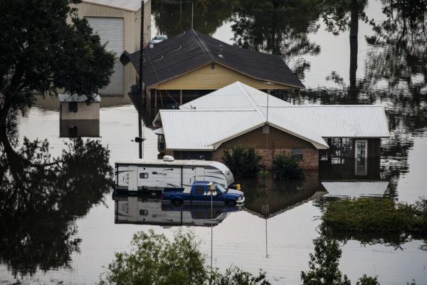 Trump hails hurricane relief efforts as he visits Texas