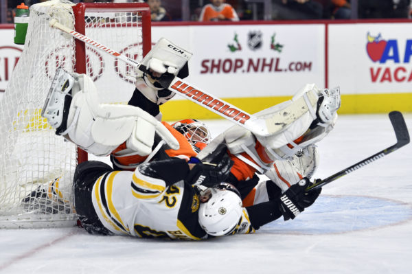 Bruins blank Flyers as Marchand returns from big hit