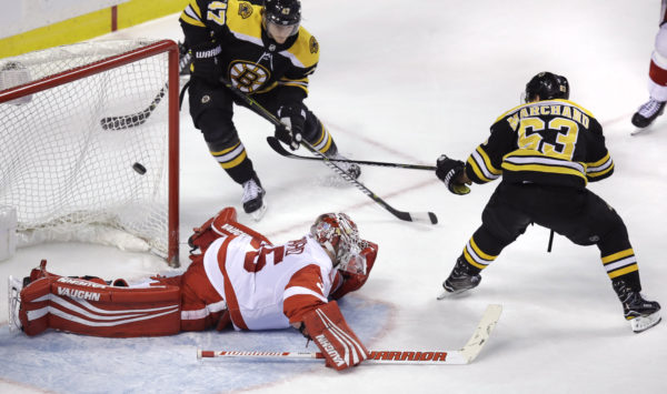 Marchand, Bruins beat Red Wings in OT