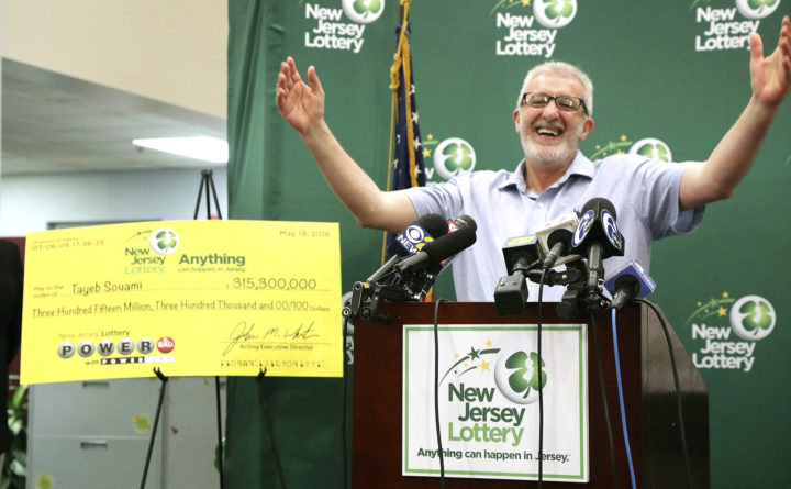 New Jersey man claims $315 million Powerball jackpot